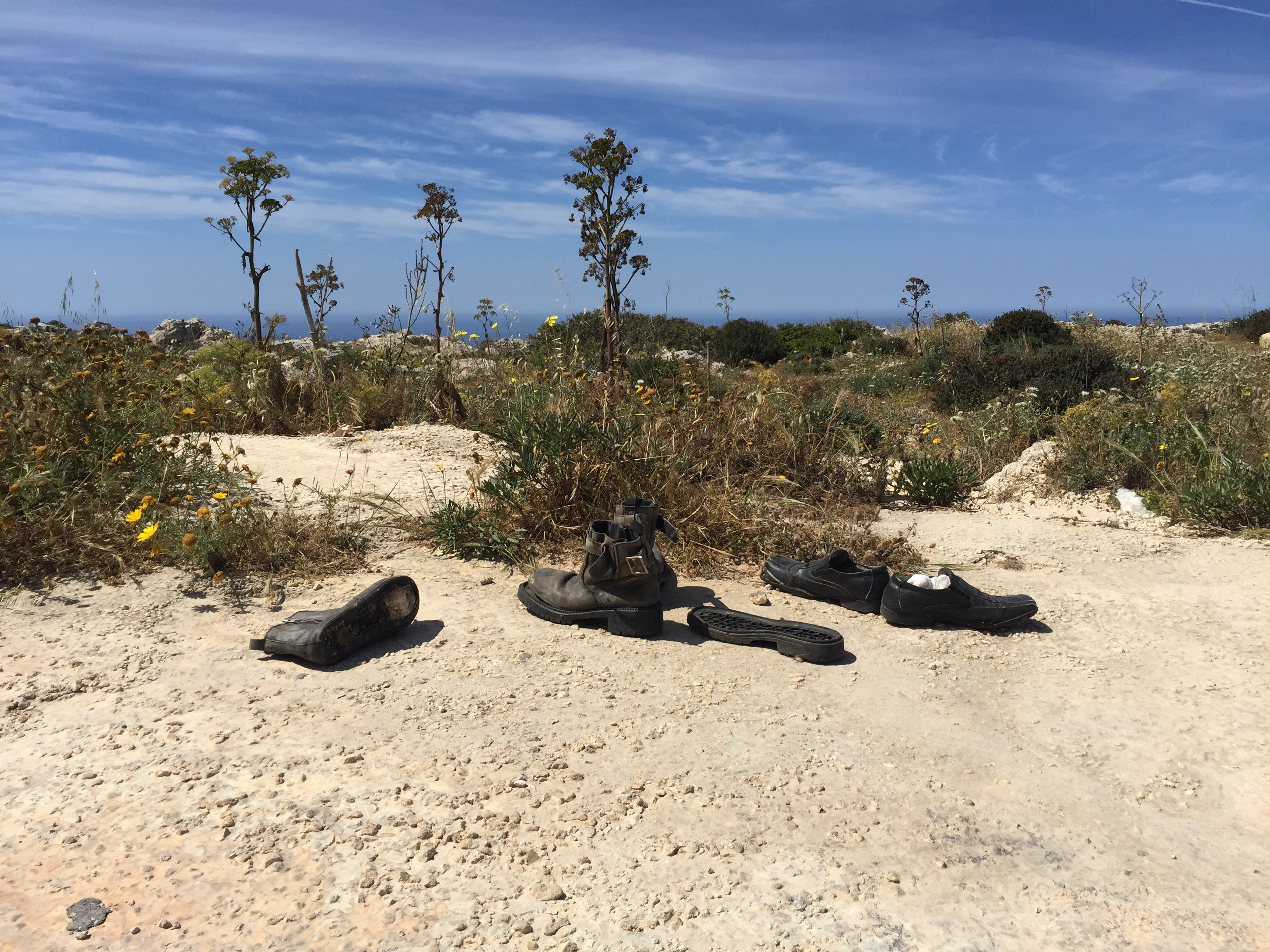 The shoes being left on the cliff in Dingli